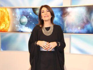 Astróloga Andrea Caricatto