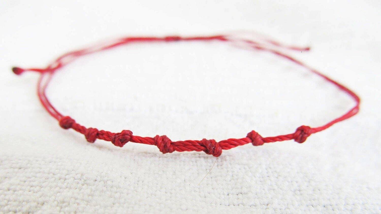 Cordón o hilo rojo para protegerte de las influencias del mal de ojo